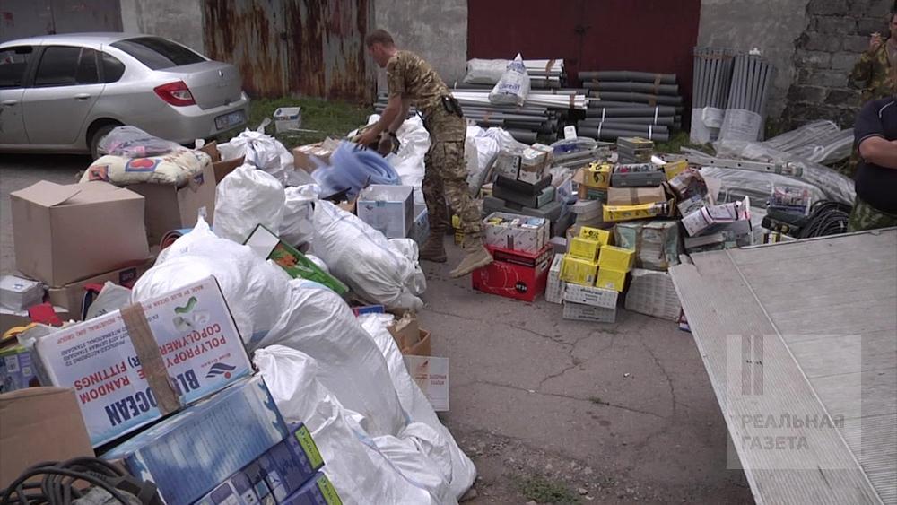 «Луганский Корейко». Мародер прятал 15 тонн награбленного в гараже! (фоторепортаж)