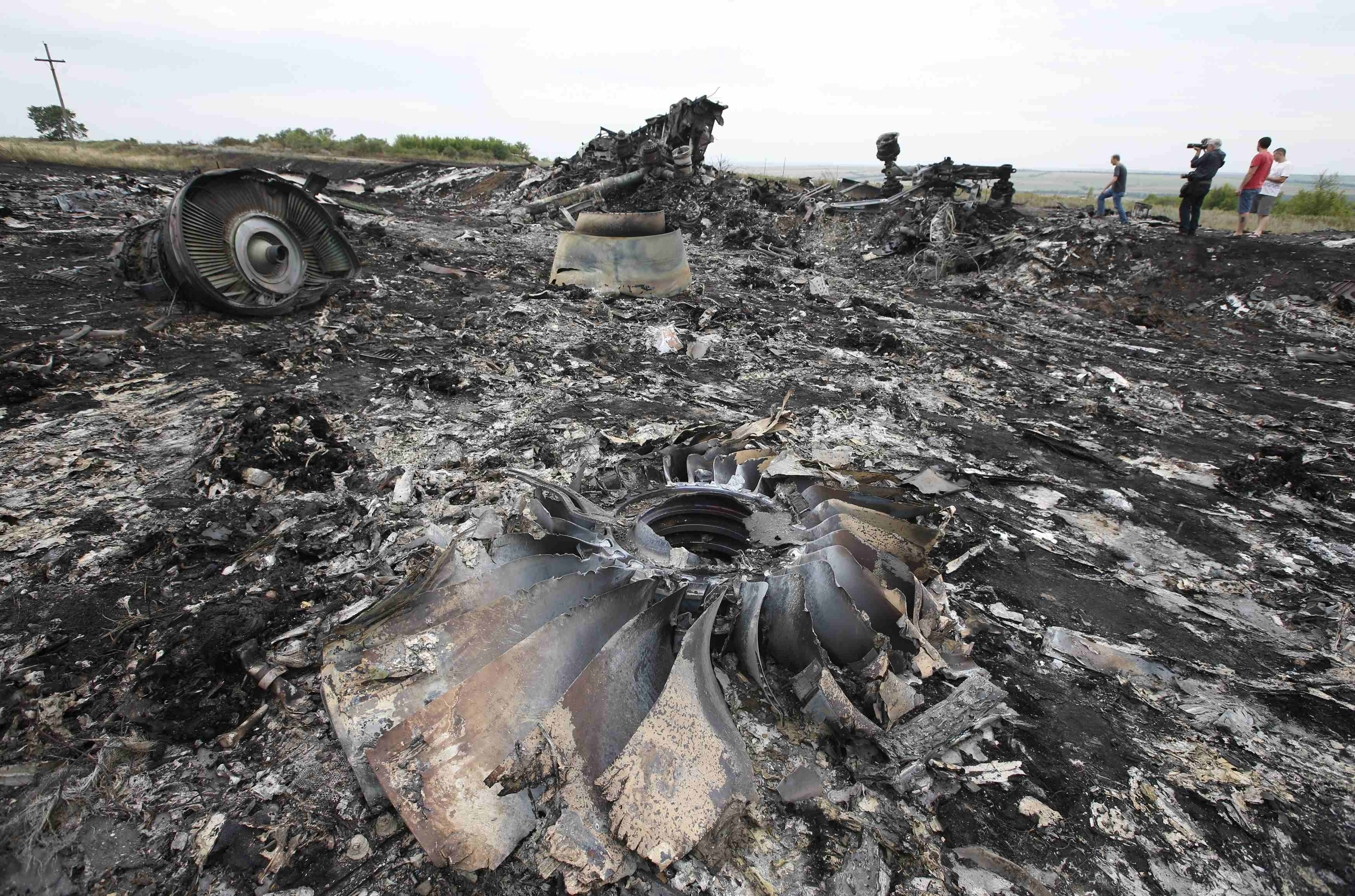 Debris is seen at the site of Thursday's Malaysia Airlines Boeing 777 plane crash near the settlement of Grabovo, in the Donetsk region