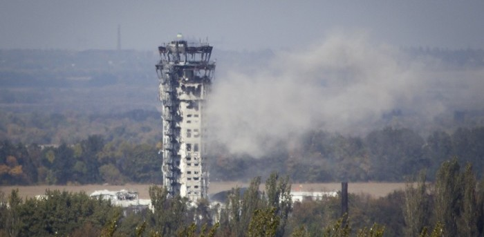 A Ukrainian national flag flies atop the traffic control tower of the Donetsk Sergey Prokofiev International airport hit by recent shelling in Donetsk, eastern Ukraine
