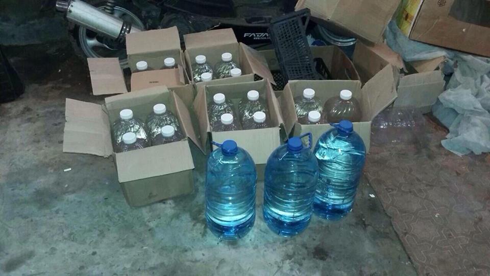 В Счастье у самогонщиков изъяли 200 литров поддельной водки (фото)