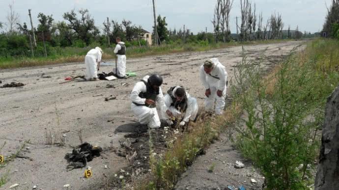 На Донбассе пытаются опознать более 80 тел погибших
